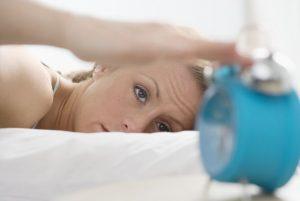 Woman Turning Off Alarm
