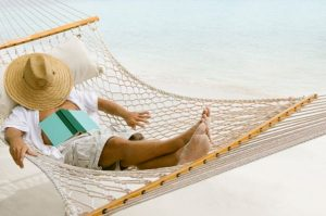 man relaxing in a hammock at the Caribbean beach